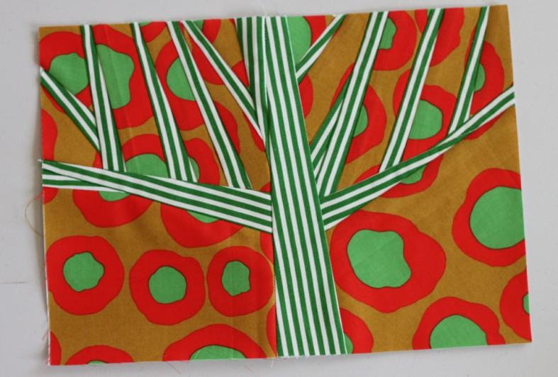orange and green grove quilt block by carolyn friedlander