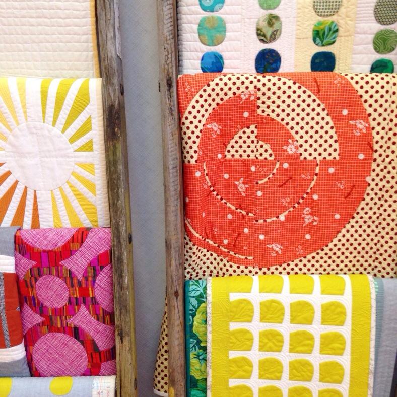 Savor Each Stitch_quilts on ladders_Carolyn Friedlander