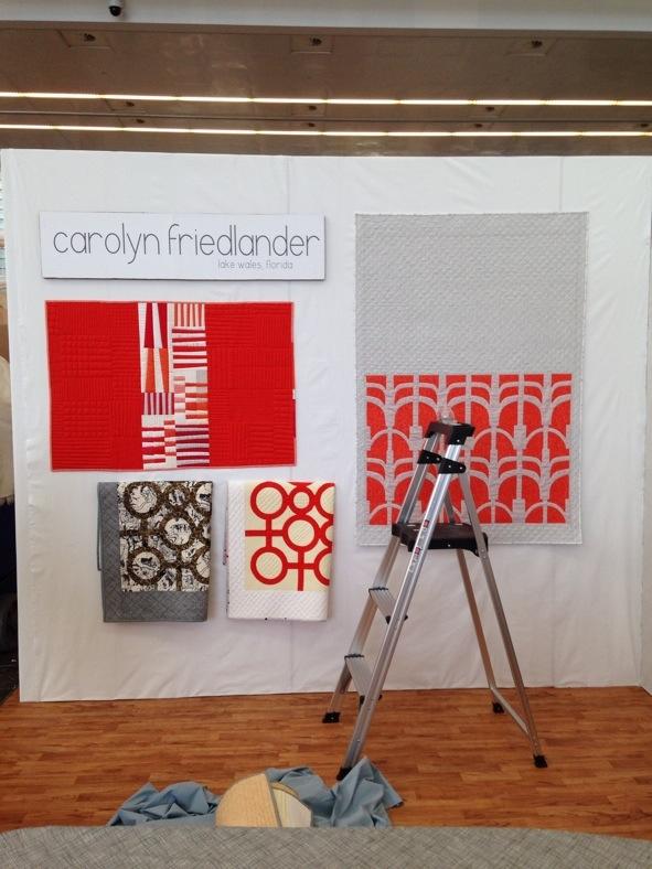 Carolyn Friedlander_Spring 14 booth under construction