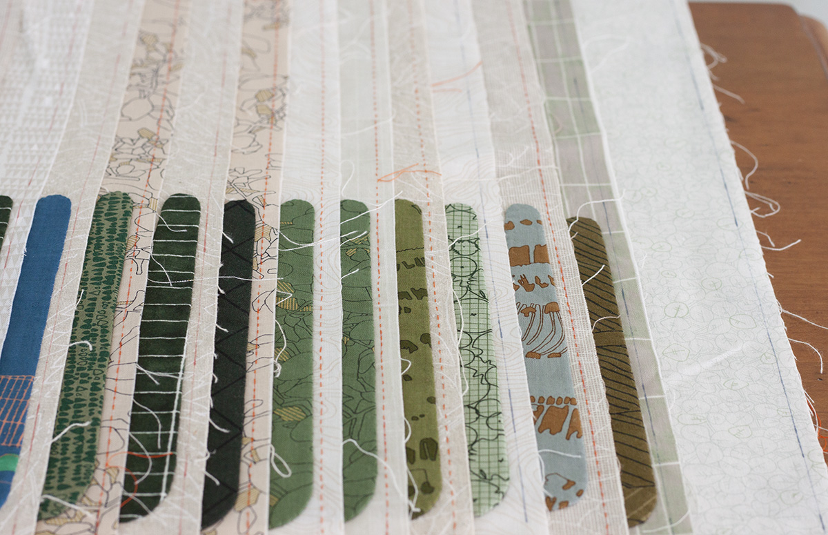 Hunt QAL #7 quilt blocks with lots of greens