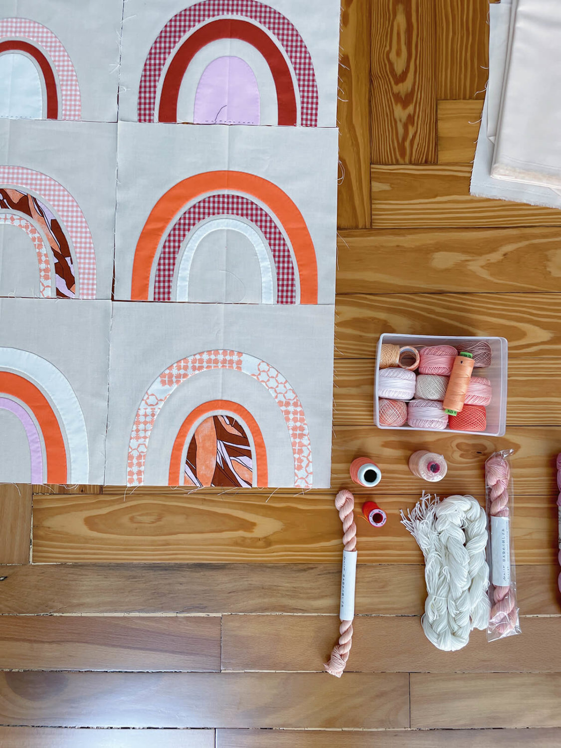 Bow Jetty and Kept quilt with quilting threads . carolyn friedlander