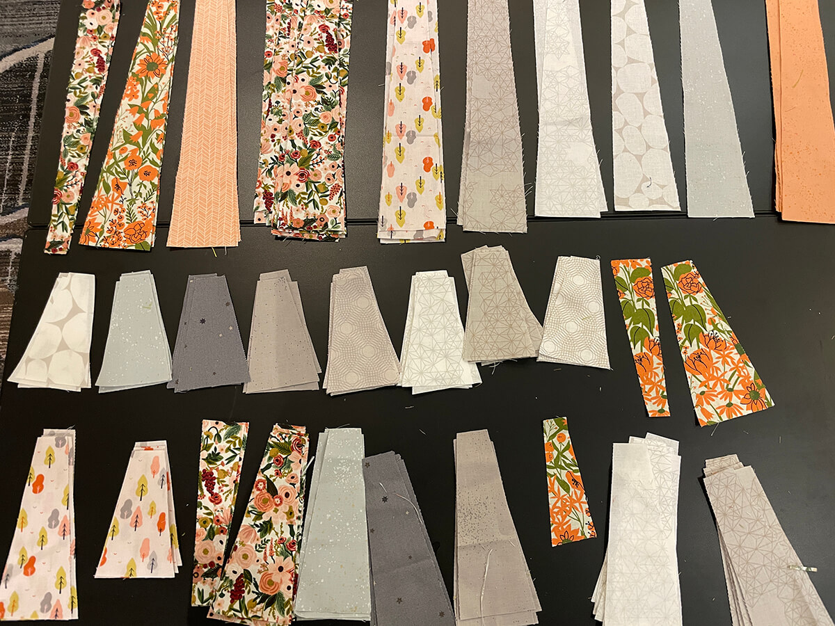 long leaf quilt pieces in floral and grey fabrics