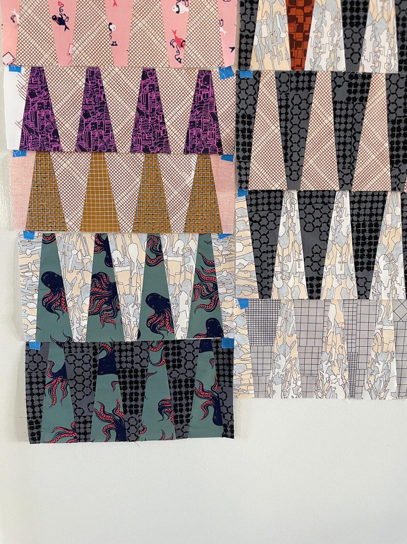 long leaf quilt pieces by carolyn friedlander in scrappy fabrics