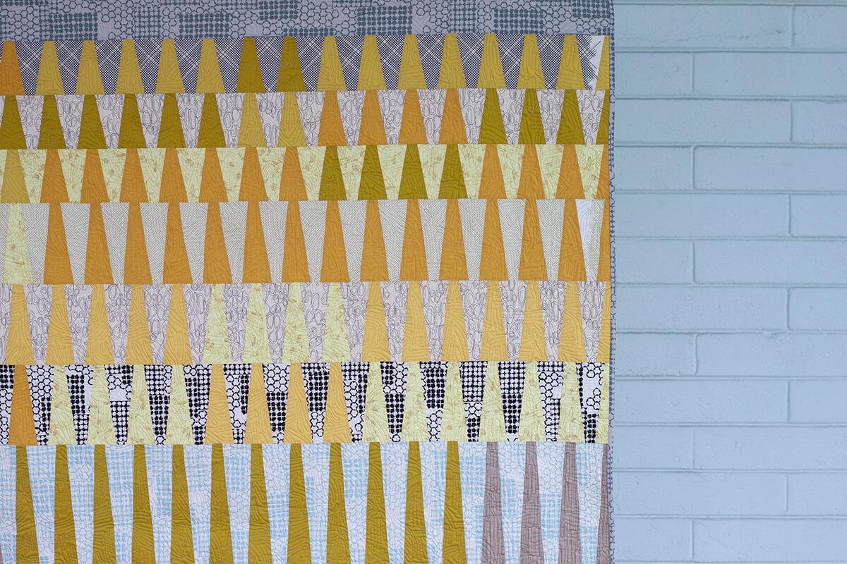 row order long leaf quilt in kept fabrics . carolyn friedlander