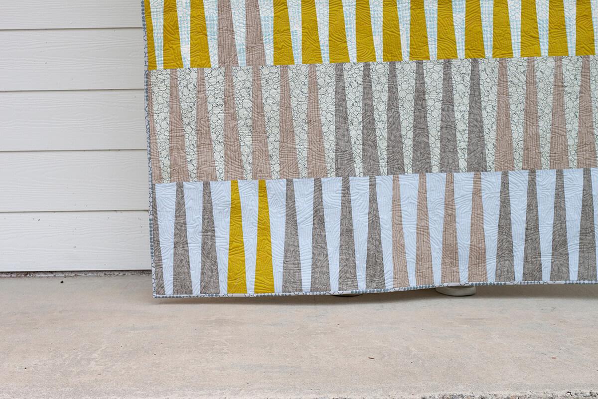 close up of long leaf quilt in kept fabrics . carolyn friedlander