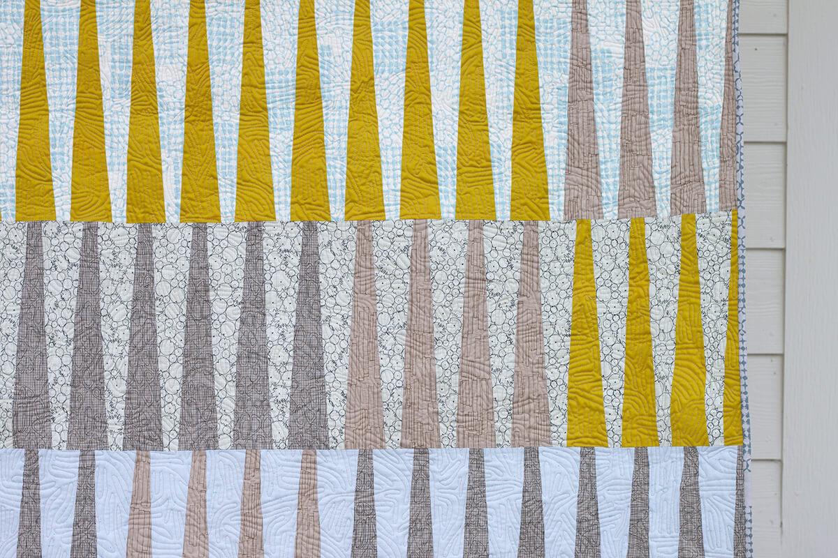 quilting of long leaf quilt in kept fabrics . carolyn friedlander