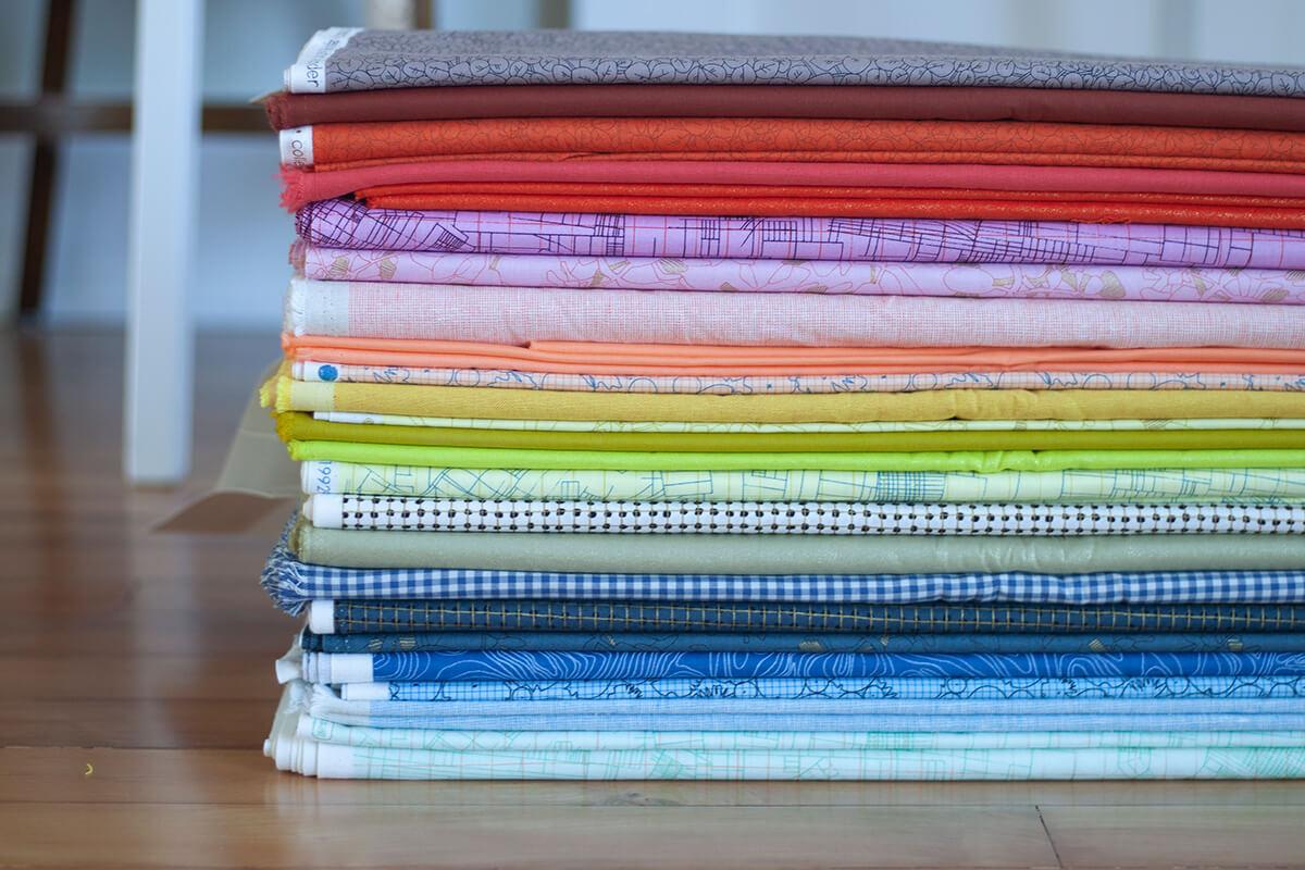 Cheering fabric bundles . carolyn friedlander